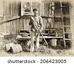 male farmer holding a pitchfork.... | Shutterstock . vector #206423005