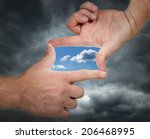 holding hands up and seeing a... | Shutterstock . vector #206468995