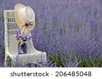 Hat On Wicker Chair With Jar O...