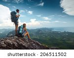 hikers standing on top of the... | Shutterstock . vector #206511502