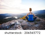 young woman sitting on a rock... | Shutterstock . vector #206565772