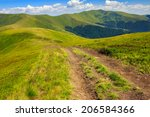 wide trail near the lawn in high mountains - stock photo