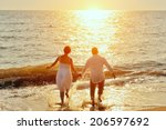 happy couple running to the... | Shutterstock . vector #206597692