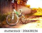 white bicycle on rural road on... | Shutterstock . vector #206638156