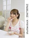 woman drinking supplements | Shutterstock . vector #206738962
