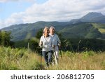 senior people hiking in... | Shutterstock . vector #206812705