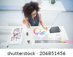 pretty designer working at her... | Shutterstock . vector #206851456