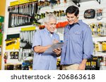 smiling father and son checking ... | Shutterstock . vector #206863618