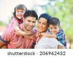 cute family portrait of 4 people | Shutterstock . vector #206962432