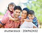 cute family portrait of 4 people | Shutterstock . vector #206962432