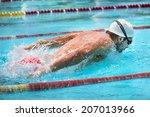 man swims butterfly style in ... | Shutterstock . vector #207013966