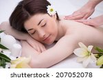 relaxed woman with flowers in... | Shutterstock . vector #207052078