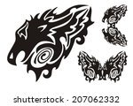 tribal dragon head and twirled... | Shutterstock .eps vector #207062332