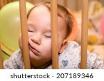 baby sleeps with funny face in... | Shutterstock . vector #207189346