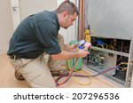 hvac technician charging a heat ... | Shutterstock . vector #207296536
