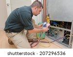 hvac technician charging a heat ... | Shutterstock . vector #207296536