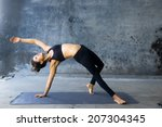 woman practicing advanced yoga... | Shutterstock . vector #207304345