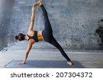 woman practicing advanced yoga... | Shutterstock . vector #207304372