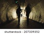 Two People Walking In The Dark...