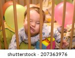 baby sleeps in the playpen with ... | Shutterstock . vector #207363976