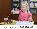 happy little girl drawing with... | Shutterstock . vector #207374602