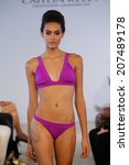 miami   july 19  model walks... | Shutterstock . vector #207489178