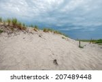 sand dunes with grasses and... | Shutterstock . vector #207489448