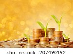 young trees growing on coins... | Shutterstock . vector #207490192