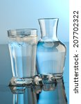 glass and bottle of water   Shutterstock . vector #207702322