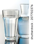 glass and bottle of water | Shutterstock . vector #207702376