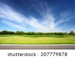 Green Meadow And Blue Sky With...