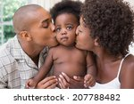 happy couple on bed with baby... | Shutterstock . vector #207788482