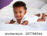 cute baby lying on tummy in... | Shutterstock . vector #207788566