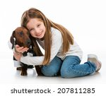 Stock photo little girl with dolittle girl with a dog breed dachshund isolated on white backgroundg 207811285