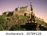 Edinburgh Castle at dusk from Princes St Gardens - stock photo