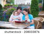 happy family of four  young... | Shutterstock . vector #208033876