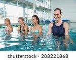 female fitness class doing aqua ... | Shutterstock . vector #208221868