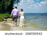 bride and groom on the beach  a ... | Shutterstock . vector #208550542