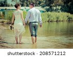 bride and groom on the beach  a ... | Shutterstock . vector #208571212