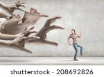 young woman in casual escaping...   Shutterstock . vector #208692826
