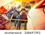happy couple riding on ferris... | Shutterstock . vector #208697392