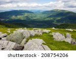 white sharp boulders on the hillside - stock photo