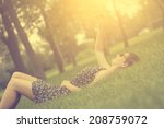 vintage photo of woman taking a ... | Shutterstock . vector #208759072