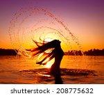Beauty Model Girl Splashing...