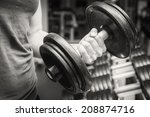 muscular arm in the gym. hand... | Shutterstock . vector #208874716