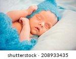 newborn baby boy asleep  | Shutterstock . vector #208933435