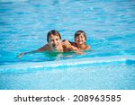 smiling man with boy in... | Shutterstock . vector #208963585