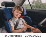 little boy sitting in safety...   Shutterstock . vector #209014222