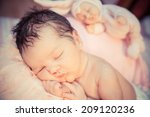 newborn baby peacefully sleeping | Shutterstock . vector #209120236