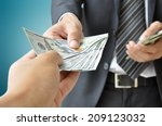 hand receiving money from... | Shutterstock . vector #209123032